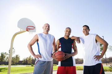 Men playing basketball outdoors