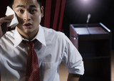 Asian man sweating backstage