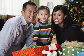 Asian family with Christmas gifts