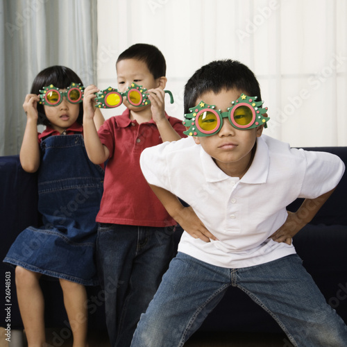 Asian siblings in funny sunglasses