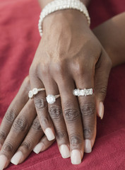 African woman wearing many diamond rings