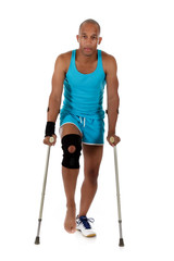 Young  attractive African American man athlete, crutches