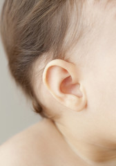 Close up of mixed race baby girlÕs ear