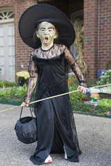Mixed race girl in witch costume
