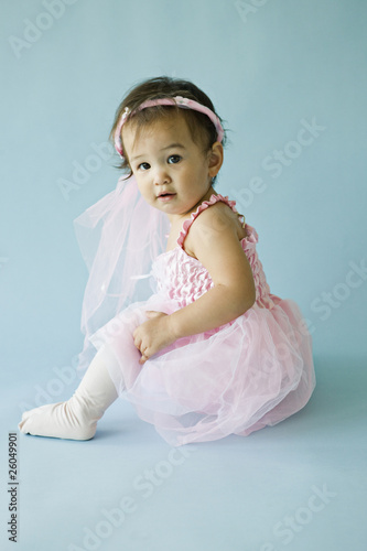 Mixed race baby girl in princess costume
