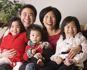 Asian family smiling together