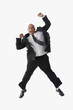 Hispanic businessman cheering and jumping in air