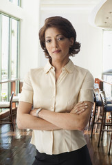 Hispanic businesswoman with arms crossed