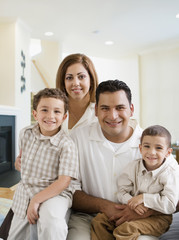Hispanic family smiling in living room