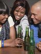 African friends drinking beer in nightclub