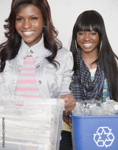 African women carrying recycling bins
