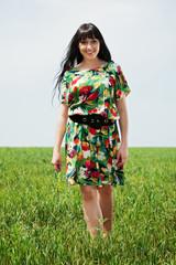 beautiful woman walking on the meadow