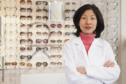 Korean optician standing in store