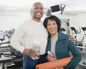 African couple standing in health club