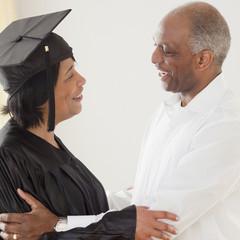 African man congratulating graduating wife