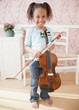 African girl holding violin