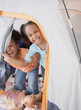 African girls playing in tent