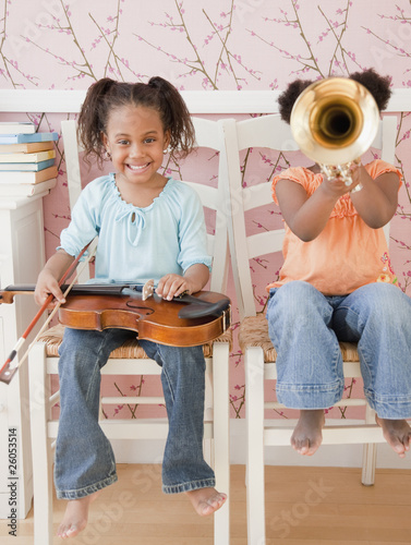 African girls playing instruments