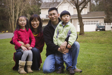 Korean family posing front yard