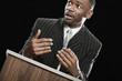 African man gesturing at podium