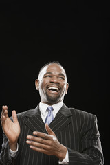 African man in suit laughing