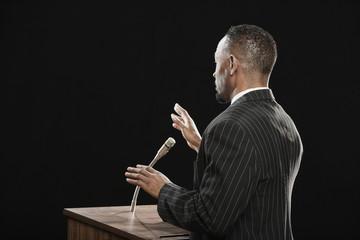 African man speaking at podium
