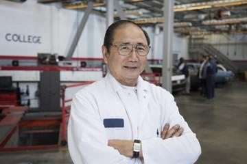 Japanese mechanic in auto body shop