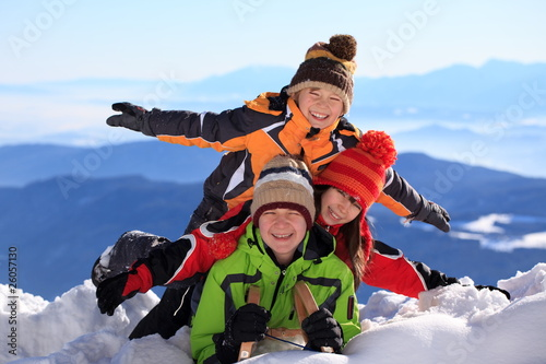 Children on snowy mountain