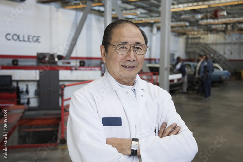 Japanese mechanic in auto body shop