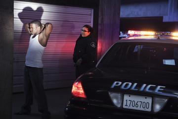 Policewoman arresting man