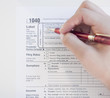 Woman completing tax form