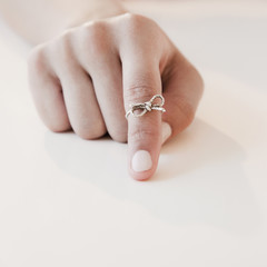 Woman with string tied around forefinger