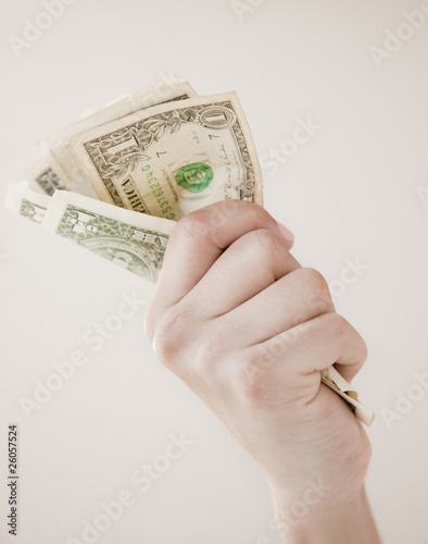Woman gripping dollar bills
