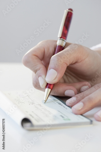 Woman writing personal check