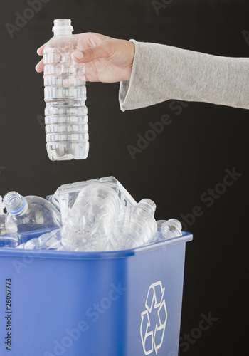 Woman recycling plastic bottle
