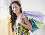 Mixed race woman holding shopping bags