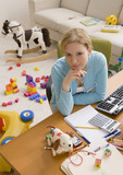 Hispanic woman at desk surrounded by toys