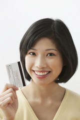 Filipino woman holding credit card