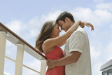 Couple hugging face to face on cruise ship