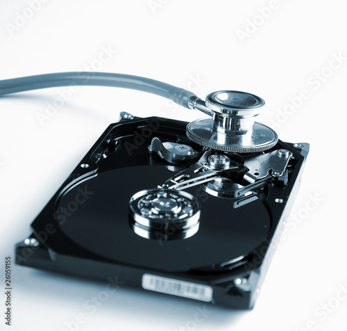 Computer hard drive and a stethoscope.