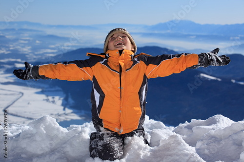 Happy boy on snowy mountain
