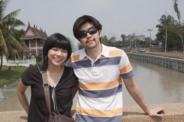 Asian couple outside of temple