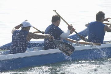 Outrigger canoeing team paddling