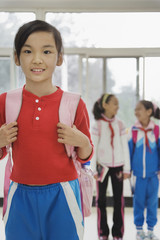 Chinese student wearing backpack