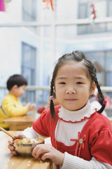Chinese girl eating lunch