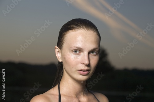 Portrait of young woman in swimming costume at dusk