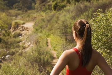 Hispanic woman looking at nature trail