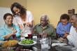 Multi-generation family eating dinner