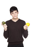 Caucasian man comparing lime to lemon poster