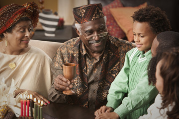 Multi-generation family celebrating Kwanzaa